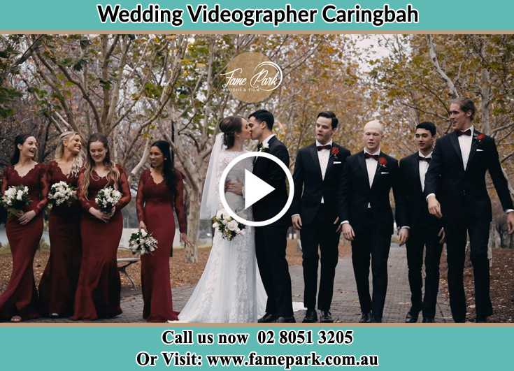 Bride and Groom kissed with their secondary sponsors Caringbah NSW 2229