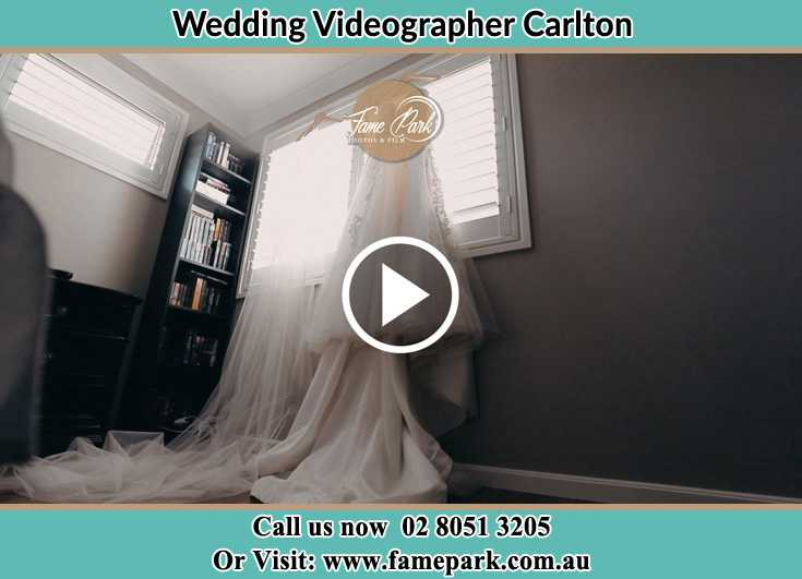 Bride wedding gown hang at the window Carlton NSW 2218