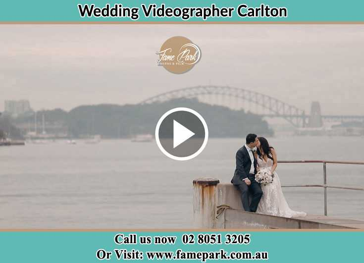 Bride and Groom kissed while sitting on near the shore Carlton NSW 2218