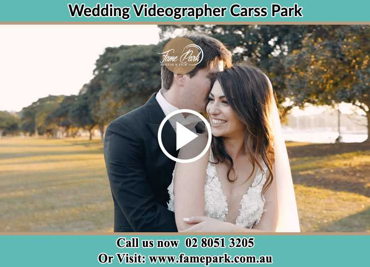 Bride and Groom hold each other at the park Carss Park NSW 2221