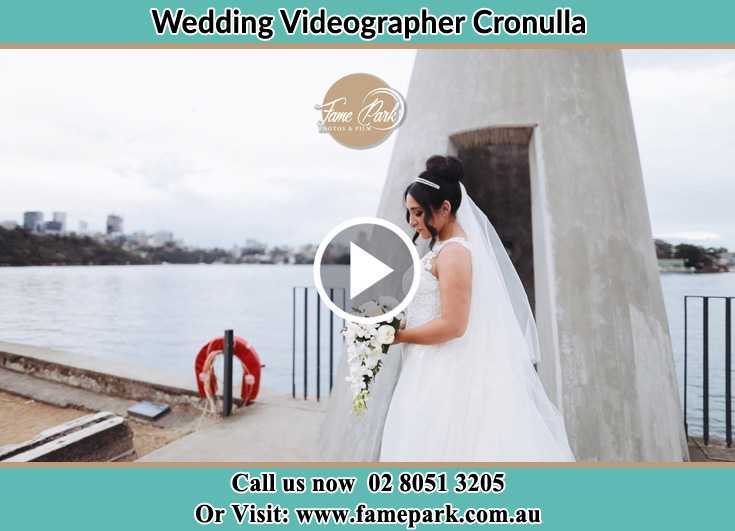Bride near the shore hold a bouquet of flowers Cronulla NSW 2230