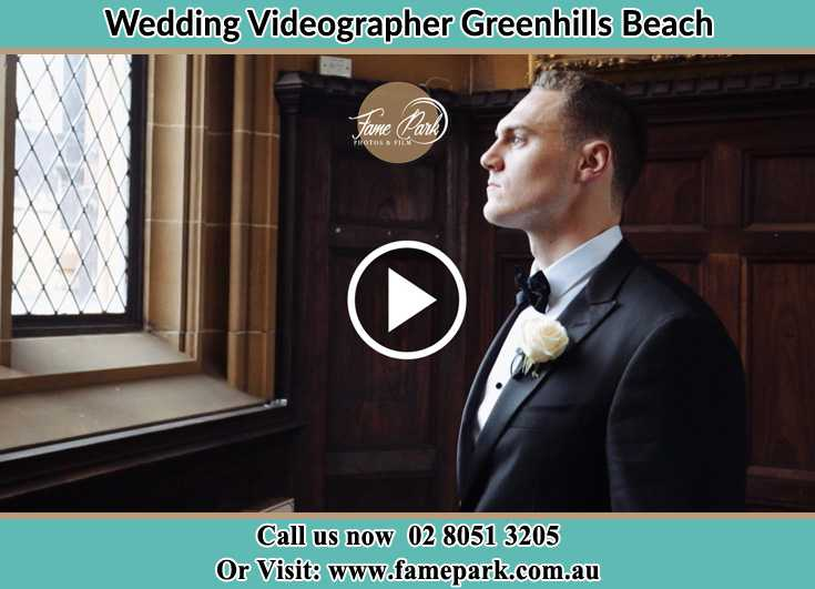 Groom looking at the church window Greenhills Beach NSW 2230