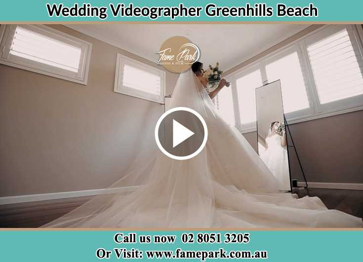 Bride already prepared in front of the mirror Greenhills Beach NSW 2230