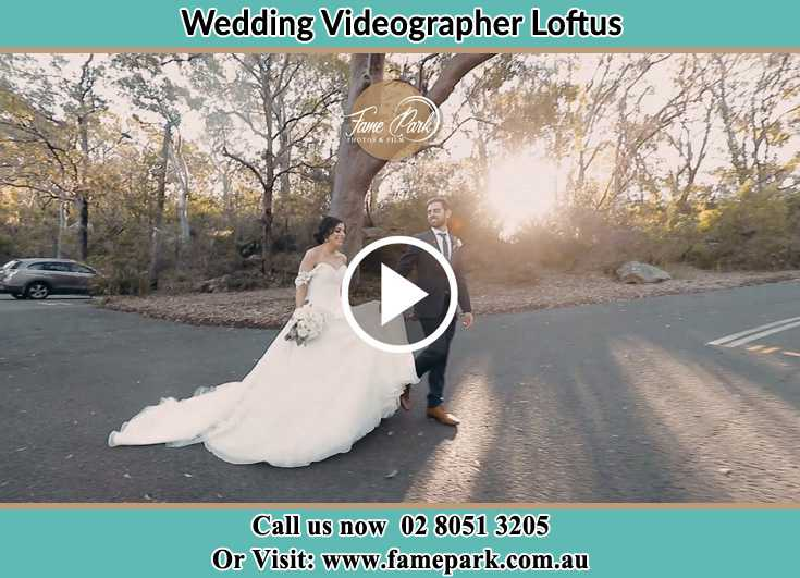 Bride and Groom walking at the park Loftus NSW 2232