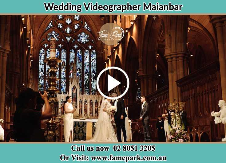Bride and Groom kissed at the altar Maianbar NSW 2230