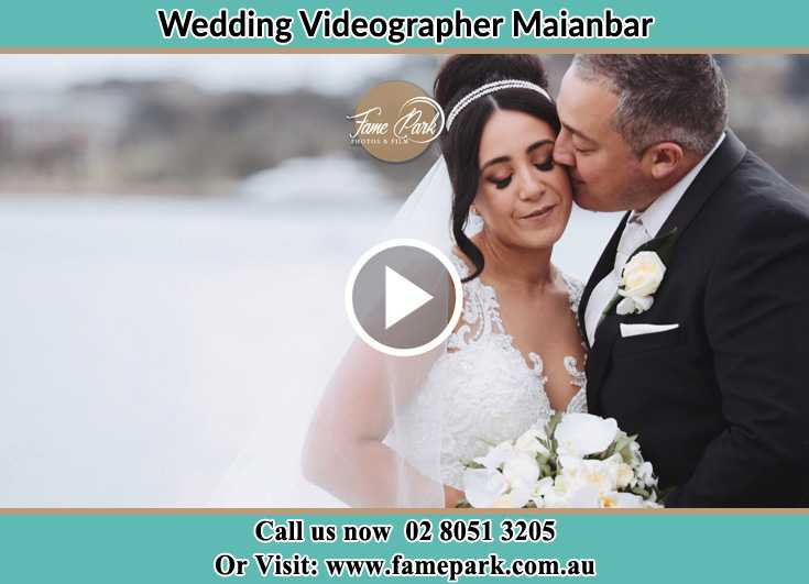 Bride and Groom kissed near the shore Maianbar NSW 2230