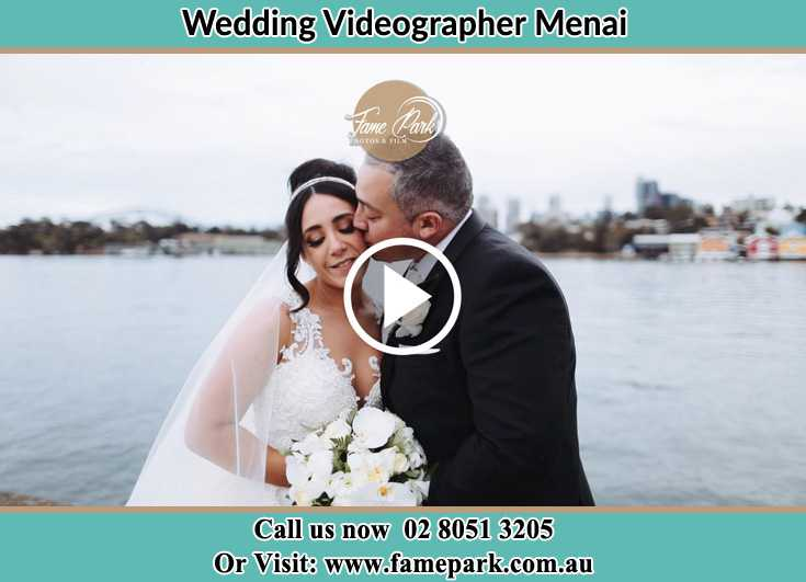 Bride and Groom kissed at the shore Menai NSW 2234