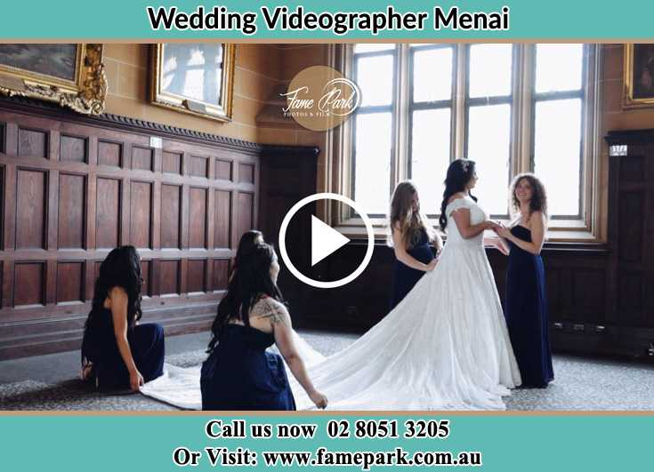 Bride and her secondary sponsors fixed her wedding gown Menai NSW 2234