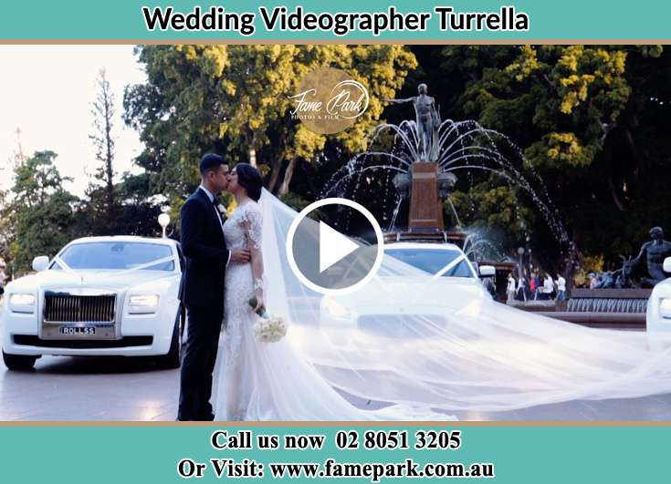 The newlyweds kissing Turrella NSW 2205