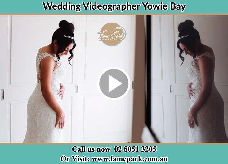 The Bride looking at her weddig gown Yowie Bay NSW 2228